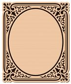decorative frame with swirls  surrounding an oval shape