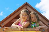 Adorable little girls outdoors in Summer