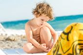 cute baby child on sea beack background