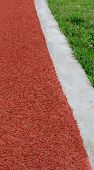 Athletics Track Lane  And Grass
