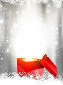 Christmas background with open gift box nestled in snow