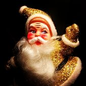 Instagram filtered image of a vintage 1950 gold sparkly Santa Claus
