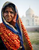 Indigenous Indian woman and Taj Mahal as a background.