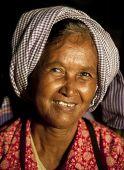 Senior native smilng at the camera.