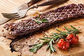 picture of machete  - Steak Machete with rosemary salt and pepper on wooden background - JPG
