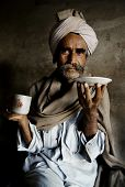 Portrait of a Rajasthani Indian man at an early morning market.