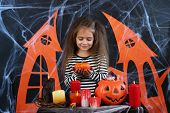 Little girl Witch in Halloween decorations