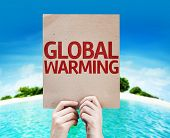 Global Warming card with a beach on background