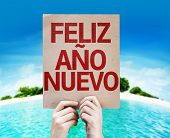Happy New Year (in Spanish) card with a beach on background
