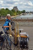 One Man Band Entertainer On The Pont Des Arts, Paris France.