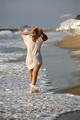 Woman And Man At Coastline