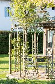 Beautiful Empty Metal Arbor In A Garden