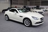 VALENCIA, SPAIN - DECEMBER 4, 2014: A white 2014 Mercedes SLK55 AMG Roadster  at the Valencia Automovil 2014 Car Show. The SLK 55 AMG was first unveiled in 2011 Frankfurt Motor Show.