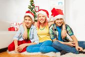 Teens kids on New year party in Santa hats
