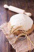 Wheat Dough On Wooden Board