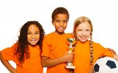 Happy diverse kids winners of soccer games