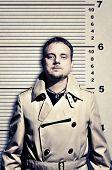 Killer Standing On Height Ruler For Photo In Prison