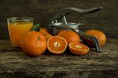 foto of juicer  - Still Life orange patterned on old wood and antique juicer - JPG