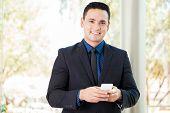 Hispanic Businessman Texting