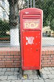 ARAD, ROMANIA - FRIDAY, DECEMBER 5, 2014: A postal box owned and managed by CN Posta Romana SA; the national operator in the field of postal services in Romania