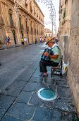 Street Musician Performing In Noto, Italy