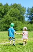 Little boy and girl hand in hand