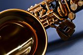 picture of saxophones  - closeup of black saxophone focus on foreground - JPG