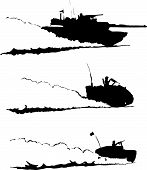 stock photo of abram  - Three silhouetted images of desert troops raising dust as they attack/patrol.