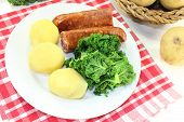picture of peeing  - a white plate with kale and pee sausage