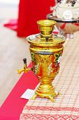 Beautiful Yellow Painted Russian Samovar With Flowers White Petals And Green Leaves