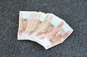 Russian Money On Grey Asphalt. 5000 Rubles Banknotes Closeup