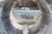 Perm, Russia - April 25, 2014: Round Ramp And Graffiti In Playground For Skateboarders