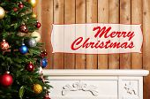 Christmas Tree in interior with fireplace on wooden wall background