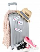 Travel suitcase, converse, photo camera and hat isolated on white