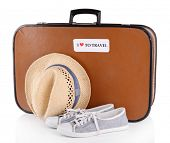 Travel suitcase, hat and shoes isolated on white