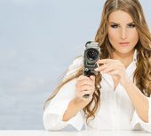 Nice, glamour lady with old camera
