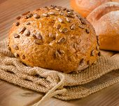 Healthy Natural Bread On  A Wooden Table
