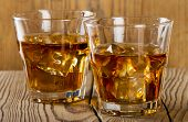 Glasses Of Whiskey On Wooden Background