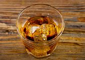 Glass Of Whiskey On A Wooden Background