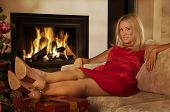 Beautiful Adult Woman By Fireplace At Home