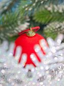 Christmas red ball and decorative snowflake out of focus