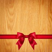 Red Ribbon And Bow, Wooden Background