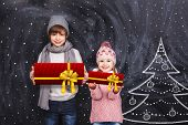 pic of little girls photo-models  - Little boy and girl are holding Christmas gifts - JPG