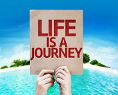 Life is a Journey card with a beach on background
