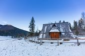 Wooden shelter in snowy Tatra mountains, Poland
