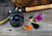 Fishing Gear On Rustic Wood