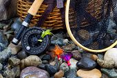 Fishing Items On Wet River Stones