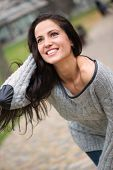 Beautiful Young Brunette Girl Smiling Outdoors