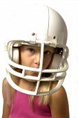 stock photo of football helmet  - Young girl with football helmet - JPG