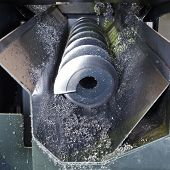 stock photo of auger  - chip auger and metal turnings from lathe machine close up - JPG